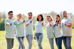 Group of volunteers showing thumbs up in park Stock Photography