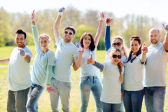 Group of volunteers showing thumbs up in park Royalty Free Stock Photo
