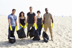Group Of Volunteers Tidying Up Rubbish On Beach Royalty Free Stock Images