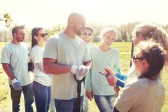 Group of volunteers with tree seedlings in park stock images