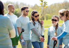Group of volunteers with trees and rake in park Royalty Free Stock Images
