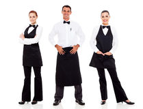 Waiter and waitress. Group of waiter and waitress full length portrait on white Royalty Free Stock Photos