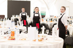 Group of waiters at a prestigious restaurant served tables to th Royalty Free Stock Photo