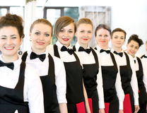 Group of waiters at a prestigious restaurant standing in the col Stock Photo