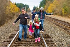 Group Walk. A group of people walking along the train tracks outside on a crisp Autumn day Royalty Free Stock Photos