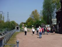 Group of walkers along the banks of a canal. royalty free stock image