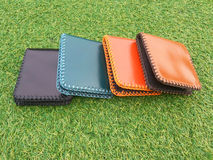 Group Wallets on grass Stock Photo