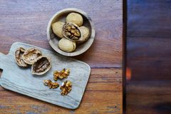 Group of walnut in wooden bowl on wood background, copy space, super food concept royalty free stock photo