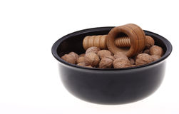 Group of walnuts in black bowl Royalty Free Stock Images