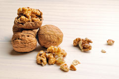 Group of walnuts on a table. Group of walnut on a white wooden table Royalty Free Stock Photography