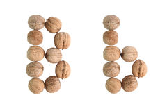 The group of walnuts on white background, making letter B. Studio shot.  Stock Photography