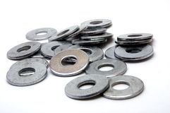 Group of Washers. A large spread out group of washers on a white background Royalty Free Stock Image