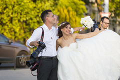 A group of wedding photographers on the streets of Budapest is holding a photo session for a couple of newlyweds. BUDAPEST, HUNGARY. 23 JUNE, 2017: A group of Royalty Free Stock Photography