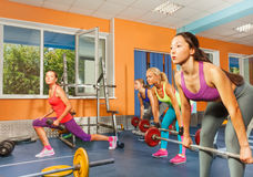 Group weight lifting class in fitness club Stock Images