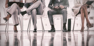Group of well dressed business people waiting Royalty Free Stock Photography