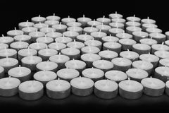 Group of white candles at a black background Stock Photo