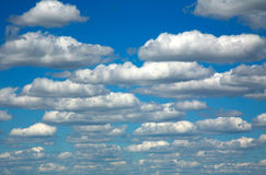Group of white clouds on a blue sky background Royalty Free Stock Images