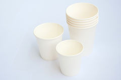 Group of white coffee cup made from cup stock paper Royalty Free Stock Images