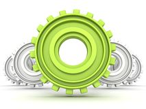 Group of white gears and one green leader Stock Photos