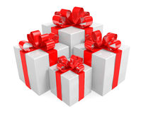 Group of white gift boxes wrapped with red ribbons tied into bows Stock Images
