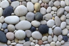 Group of white, grey and black pebbles, one by ony, simplicity stone background. Flat lay texture in daylight stock photos