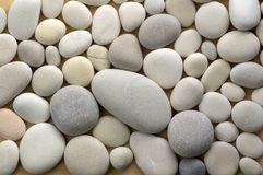 Group of white and grey pebbles, one by ony, simplicity stone background, flat lay texture in daylight. Beautiful background stock images
