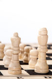 The group of white pieces on the chessboard Stock Photo