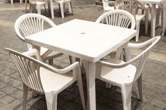 Group of White plastic table and chairs. White plastic table and chairs Stock Photo