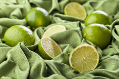 Group of whole and cut fresh limes Royalty Free Stock Photography