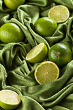 Group of whole and cut fresh limes Stock Image