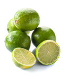 Group of whole and cut fresh limes over white background Stock Photo