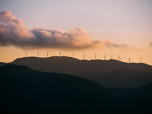 A group of Wind Generators at the top of a hill Stock Photo