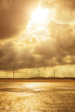 Group of Wind Power Installations in Sunset Royalty Free Stock Images