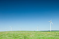 Group of wind turbines on green field Stock Image