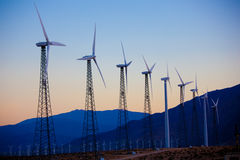 A group of wind turbines/mills in the dessert Royalty Free Stock Photos