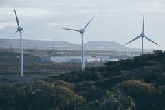 Group of windmills for electric power production.  royalty free stock photography