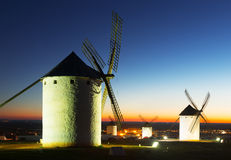 Group of  windmills at field in evening Stock Photo