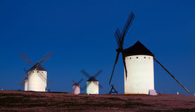 Group of  windmills at field in night Royalty Free Stock Photography