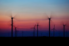 Group of windmills in motion. At sunset Stock Image
