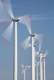 Group of windmills in motion. With blue sky. Eco energy Stock Photos