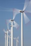 Group of windmills in motion. With blue sky Stock Photos