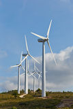 Group of windmills for renewable electric energy production. On blue sky Stock Photo