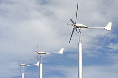 Group of windmilsl for renewable energy onl sky background Stock Images