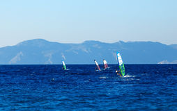 Group of windsurfers on a background  mountains in the Aegean sea . Greece Royalty Free Stock Photo