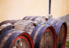 Group of wine  barrels against a stone wall Stock Photos