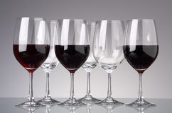 Group of wine glasses. Full and empty wine glasses Royalty Free Stock Images