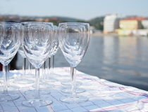 Group of wine glasses and a river Stock Images