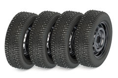 Group of winter automotive tires. Isolated on white background Royalty Free Stock Photography
