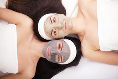 Group woman getting facial mask and gossip Stock Images
