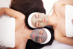 Group woman getting facial mask and gossip Royalty Free Stock Photography